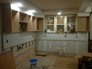 The subway tiles are in and the cabinets were delivered.