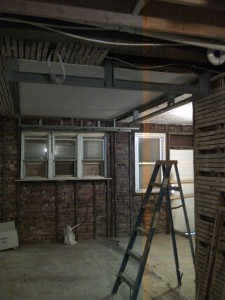 At this point, the majority of plumbing drain pipes are in place. I chose to start on the non-structural steel soffits, in the kitchen area and gain a better perspective of what space I have to work with.