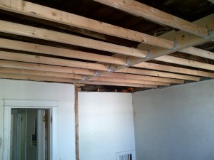 I was also concerned with the structural integrity of the ceiling in the bedroom. So I decided to shore up the ceiling and insulate since the weather was getting colder outside. I was afraid of the cold temperatures affecting the bathroom tiles which needed to be set. It also helped with bearing weight along the older walls. I used a combination of steel track and wood studs to secure new material to old work and parting walls.