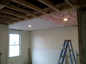 The weather did change before expected and it was necessary to finish the bedroom ceiling before the bathroom tiles were set.
